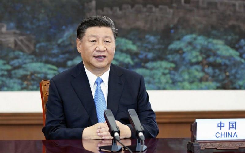 22日の国連総会一般討論で放映されたビデオで演説する中国の習近平国家主席=新華社・共同
