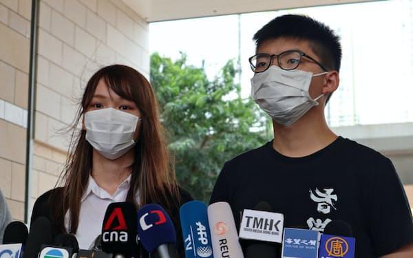 活動家の黄之鋒氏(右)は周庭氏らと香港の民主化を訴えていた(8月)