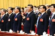 習近平指導部にとって新疆ウイグル政策は重要課題となっている(5月25日、北京)=共同