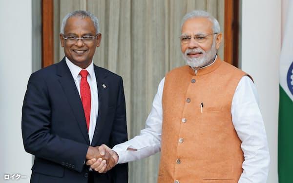 ソリ大統領(左)はモディ首相との連携も進める(18年、ニューデリー)=ロイター