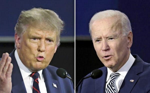 29日、米オハイオ州クリーブランドで開かれた大統領選候補者討論会で話すトランプ大統領(左)とバイデン前副大統領=ゲッティ・共同