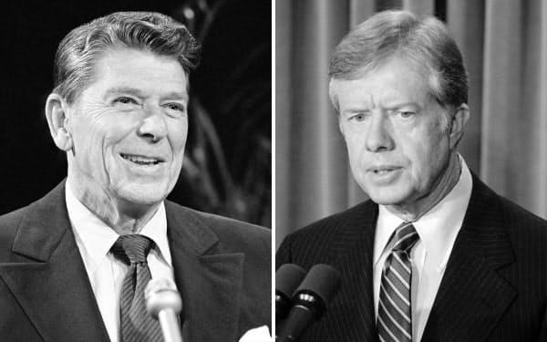 レーガン氏(写真左)とカーター氏(1980年)=AP