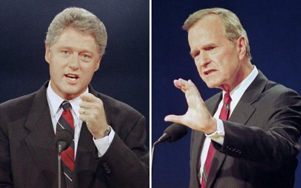クリントン氏(写真左)とブッシュ(父)氏(1992年)=AP