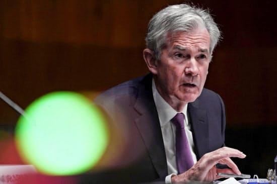 パウエルFRB議長はIMFとの討論会で、中央銀行が発行するデジタル通貨の研究を進める考えを表明した=ロイター