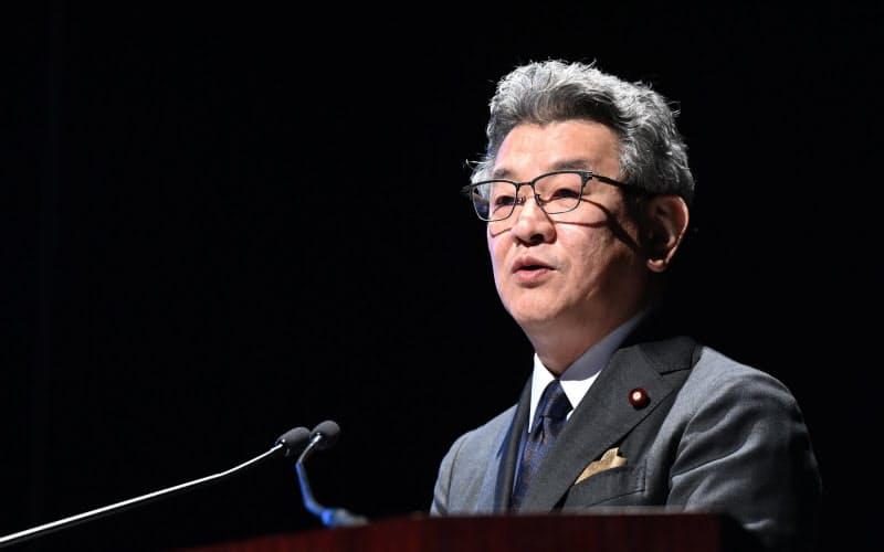 講演する武田総務相(21日、東京都中央区)
