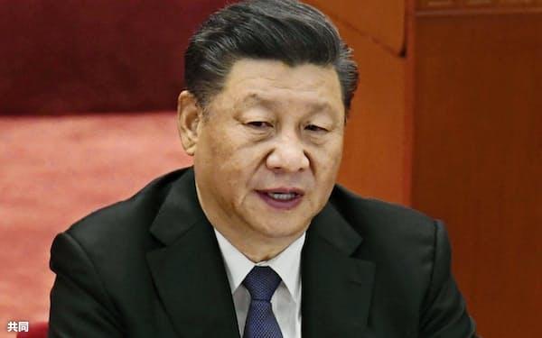 中国軍の朝鮮戦争参戦から70年を記念する大会で演説する習近平国家主席=10月23日、北京の人民大会堂(共同)
