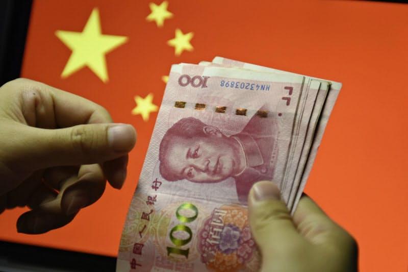 中国はデジタル通貨の発行をにらみ法制度を整備する=AP