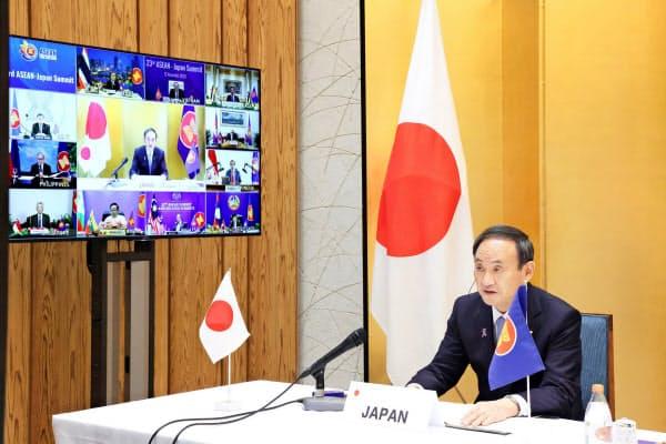 12日にオンラインでASEAN各国首脳との会合に臨んだ菅首相=内閣広報室提供・共同