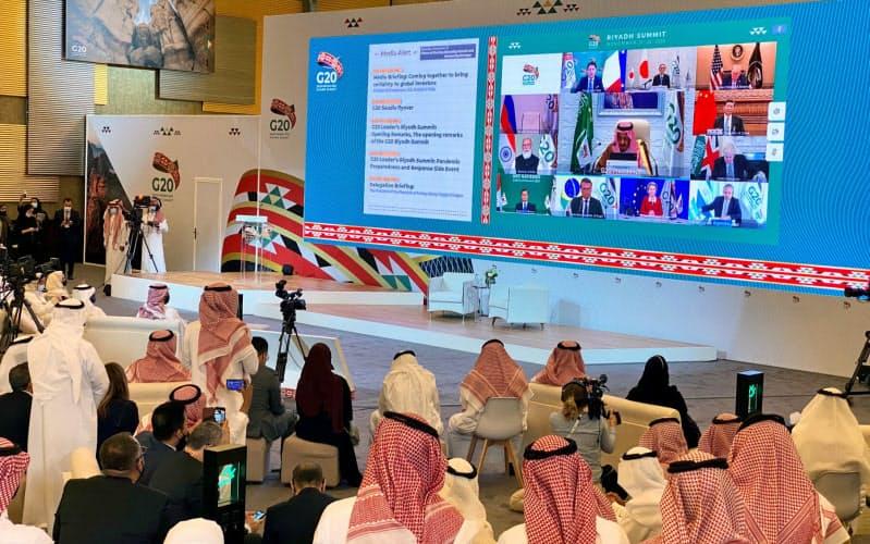 テレビ会議方式で開かれたG20首脳会議(21日、リヤド)=ロイター
