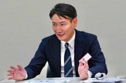 記者会見するジオコードの原口大輔社長(26日)