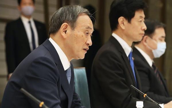 経済財政諮問会議であいさつする菅首相(27日、首相官邸)