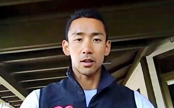 強化合宿中の福井県内でオンライン取材に応じるボートの西村光生(26日)=共同
