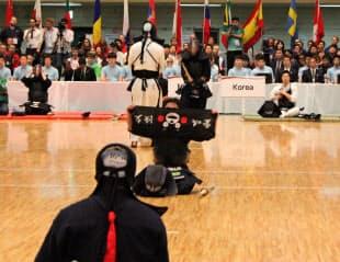 ブラジルのタケイ選手が使った「くまモン」の手拭いに会場が沸いた