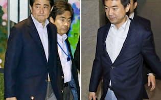 会談を終え、ホテルを出る安倍首相(左)と維新の党最高顧問の橋下徹大阪市長(14日夜、東京都港区)=共同