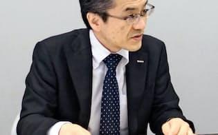キーエンスの山本晃則社長は「今後も安定した配当を継続したい」と述べた(5月7日、大阪取引所)