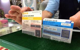 金券店の売値はANA優待券の上昇が目立つ(写真右=東京・新橋)