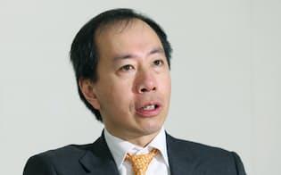 インタビューに答える英マンAHLのティム・ウォン会長