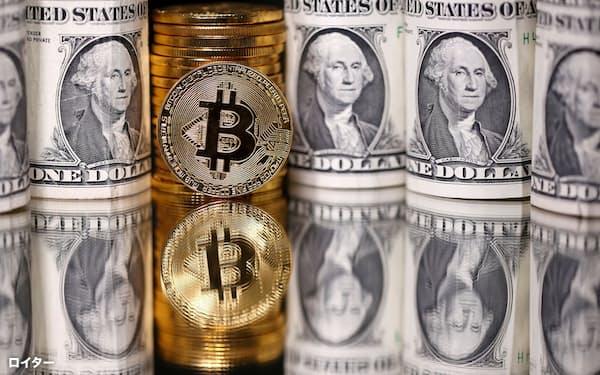 ビットコインに投機マネーが集まり乱高下を演出した=ロイター