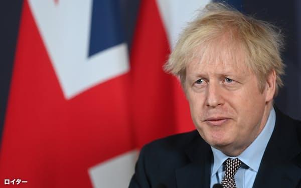 対EU交渉の合意後、記者会見するジョンソン英首相(24日、ロイター)