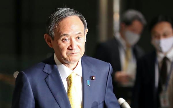 韓国地裁の判決を「断じて受け入れられない」と答えた菅首相(8日、首相官邸)