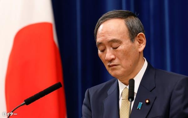 記者会見する菅首相(1月13日、首相官邸)=ロイター