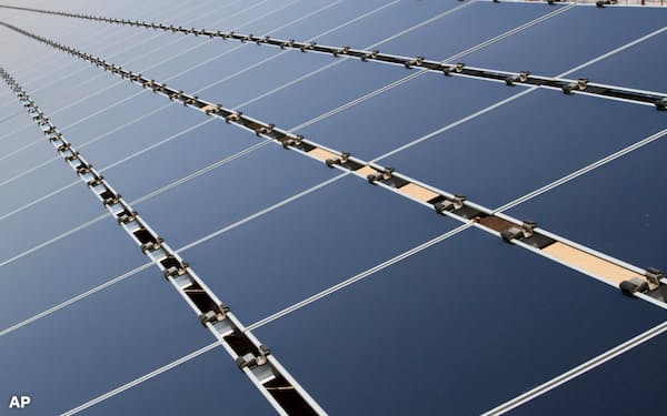 FILE - In this April 20, 2011, file photo, are some of the 30,000 solar panels that make up the Public Service Co. of New Mexico's 2-megawatt photovoltaic array in Albuquerque, N.M. A proposal that would allow for community solar programs to be established in New Mexico has cleared its first legislative hurdle despite questions from some lawmakers and concerns among investor-owned utilities. The bill cleared the Senate Conservation Committee on a party-line vote Thursday Jan. 28, 2021. (AP Photo/Susan Montoya Bryan, File)