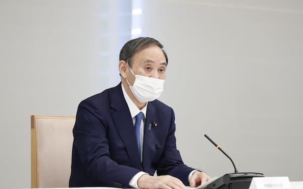 関係閣僚会議で発言する菅首相(14日、首相官邸)