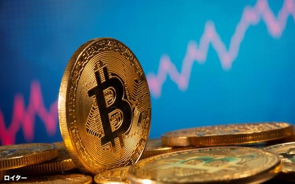 ビットコインは伝統的な金融業界の中枢でも注目を集め始めているが、通貨機能を持ち、本格的な投資対象となるかという点では議論が分かれる=ロイター