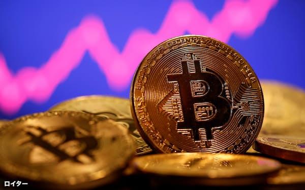価格の急騰で注目を集めるビットコイン=ロイター