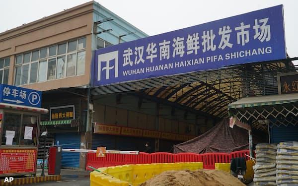 WHO調査団は、新型コロナウイルスが冷凍食品経由で武漢の食品市場に持ち込まれたとする中国側の説のい極めて懐疑的な見方を示している=AP