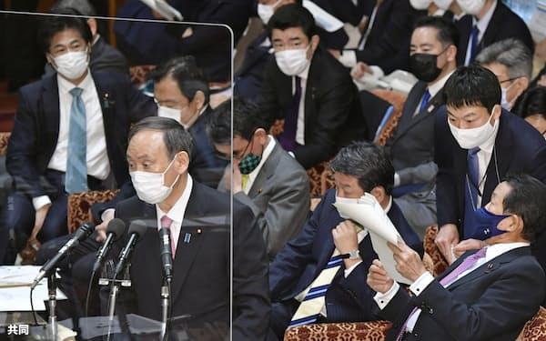 答弁する菅首相