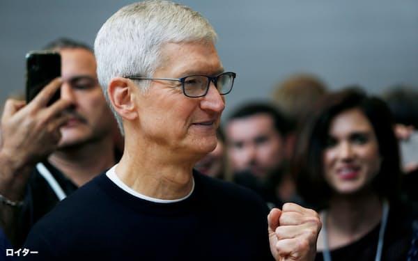 アップルのクック氏は東日本大震災直後の2011年8月にCEOに就任した=ロイター