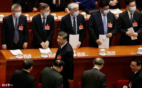 中国全人代が香港の選挙制度を見直しを決めたのは、中国政府が自らの主張を貫くのに一切の妥協を許さない決意表明でもあるとされる=ロイター
