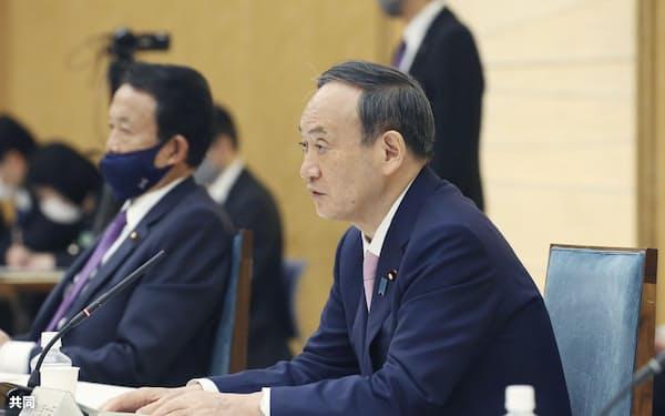 経済財政諮問会議であいさつする菅首相(22日午後、首相官邸)=共同
