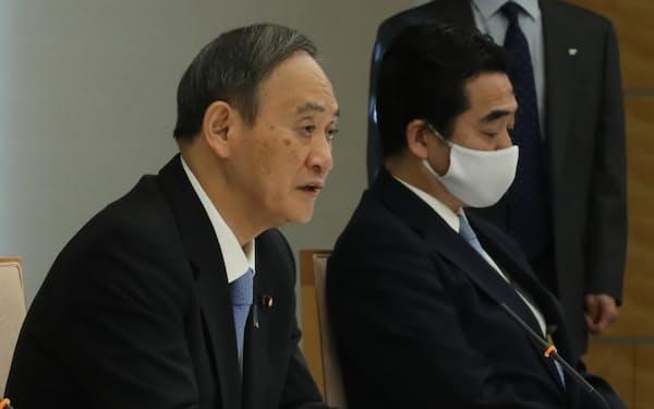 皇位継承に関する式典委員会であいさつする菅首相(23日午前、首相官邸)