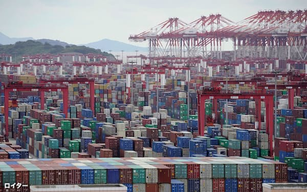 FILE PHOTO: Containers are seen at the Yangshan Deep-Water Port in Shanghai, China October 19, 2020. REUTERS/Aly Song/File Photo