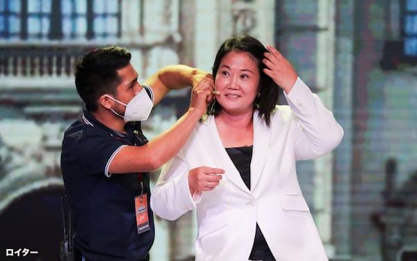 大混戦のペルー大統領選挙。フジモリ元大統領の長女、ケイコ氏も当落線上にいる=ロイター
