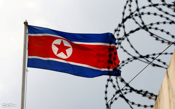 FILE PHOTO: A North Korea flag flutters next to concertina wire at the North Korean embassy in Kuala Lumpur, Malaysia March 9, 2017. REUTERS/Edgar Su/File Photo