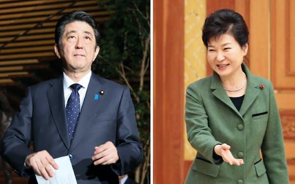 2015年12月28日、従軍慰安婦問題に関する日韓政府間合意を受け、記者の質問に答える安倍晋三首相(写真左)と韓国の朴槿恵大統領=聯合・共同