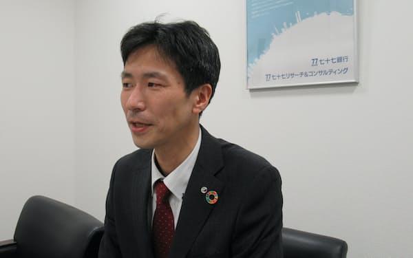 インタビューに応える田口庸友七十七R&C首席エコノミスト