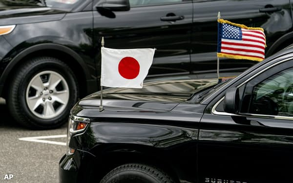 The car carrying Japanese Prime Minister Yoshihide Suga arrives for a meeting with Vice President Kamala Harris, Friday morning, April 16, 2021, at the Eisenhower Executive Office Building on the White House campus in Washington. President Joe Biden will be welcoming Japan's prime minister to the White House on Friday in his first face-to-face meeting with a foreign leader, a choice that reflects Biden's emphasis on strengthening alliances to deal with a more assertive China and other global challenges. (AP Photo/Andrew Harnik)