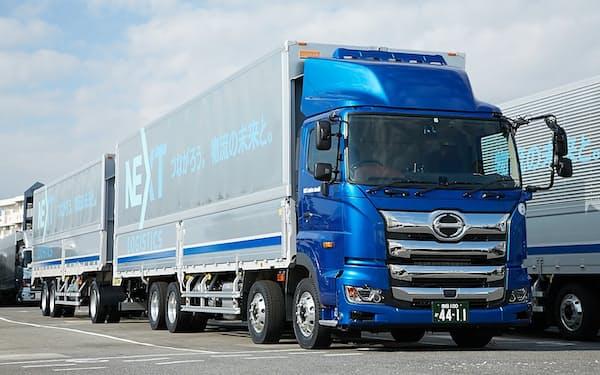 日野自動車は子会社を通じ連結トラックでの混載を進めるほか、DXでの物流効率化にも挑む