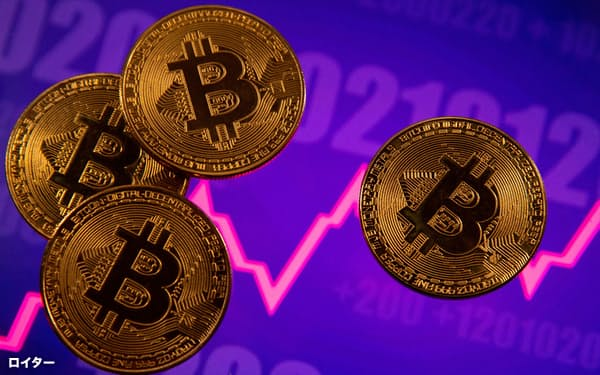 FILE PHOTO: A representation of virtual currency Bitcoin is seen in front of a stock graph in this illustration taken March 15, 2021. REUTERS/Dado Ruvic/File Photo