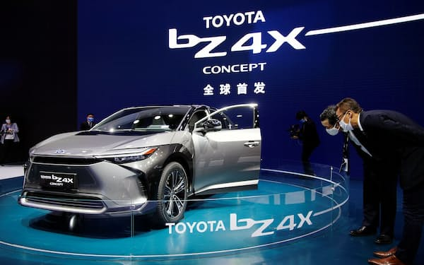 Visitors check a Toyota BZ4X Concept electric vehicle (EV) during its world premiere on a media day for the Auto Shanghai show in Shanghai, China April 19, 2021. REUTERS/Aly Song