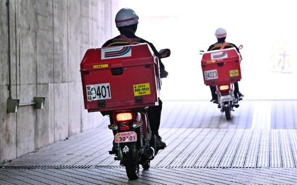 日本郵便は新システムにより配達の効率を高め、取扱量の増加に人員を増やさずに対応したい考えだ