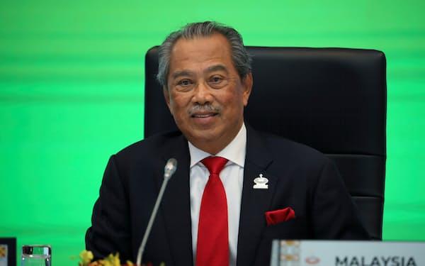 マレーシアのムヒディン首相は勅令を使って、重要な政策決定や制度変更を実施している=ロイター