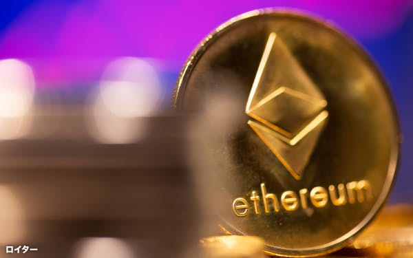 FILE PHOTO: A representation of virtual currency Ethereum is seen in front of a stock graph in this illustration taken February 19, 2021. REUTERS/Dado Ruvic/Illustration/File Photo