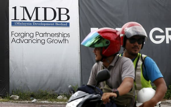 マレーシア政府は金融機関や個人への責任追及を続け、1MDB事件で不正に流出した金額以上の回収を目指す=ロイター