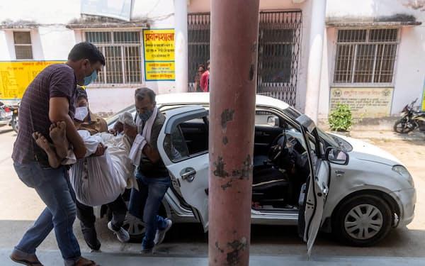 インドの新型コロナ拡大は危機的な状況が続く=ロイター