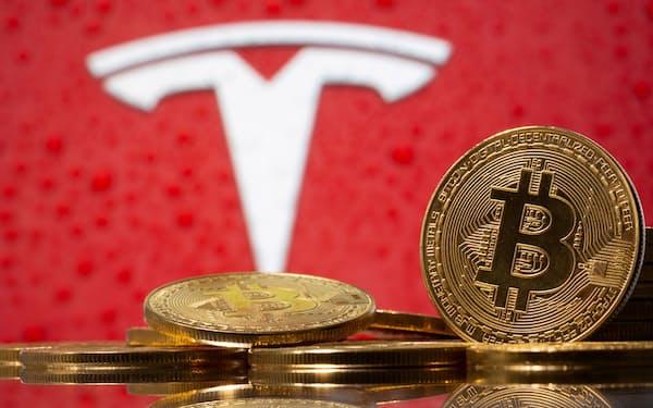 ビットコインの価格は米テスラの動向に左右されてきた=ロイター